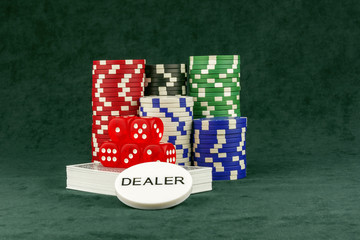 A set of accessories for poker on green cloth