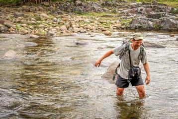 Crossing the river in tropics