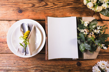 Easter menu on a wooden table decorated in eggs and fresh flower