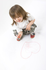 Little girl drawing isolated on a white background.