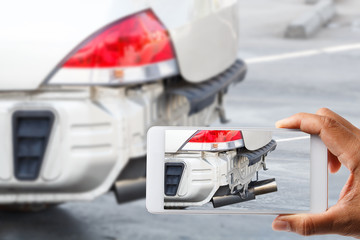 Close up hand holding smartphone and view photo of car accident