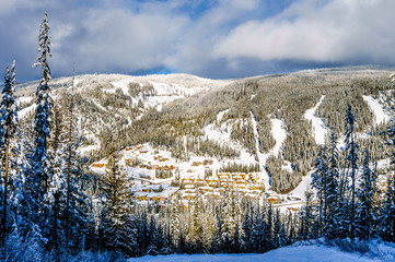 Wall Mural - The village of Sun Peaks at the foot of the Ski Slopes in a Winter Landscape on the Hills in the Shuswap Highlands of central British Columbia, Canada