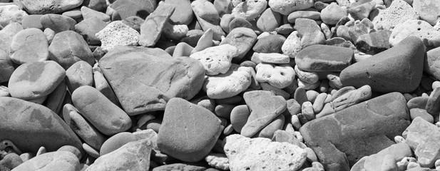 bright multi colored pebbles in sunlight - black and white