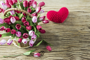 Love and valentines day concept of tulip flowers in wood basket