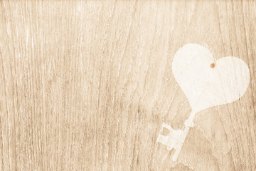 Heart key stamped on wood texture for valentine and wedding back