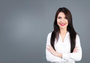 Beautiful business woman studio portrait on gray backgroung