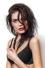 Beautiful woman portrait with wet hair wearing black bra