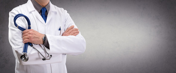 Doctor Man In Standing With Wall Background