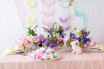 Easter still life - flowers, eggs and rabbit