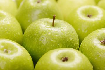 Green fresh apples close up, selective focus.