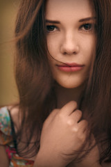 Cute young girl face close up portrait with streaming hair.