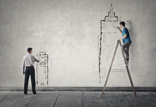 Men drawing on the wall