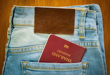 Thailand passport inside jeans pocket with brown leather tag