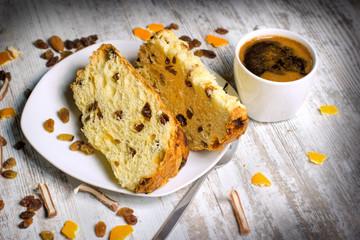 Fruit cake with raisins and candied fruit and cup of fresh coffee