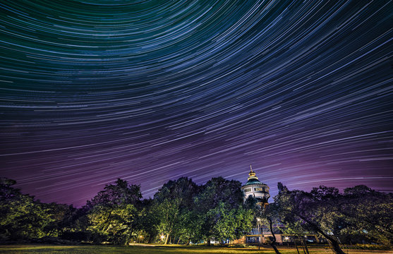 Startrails night sky over the watertower