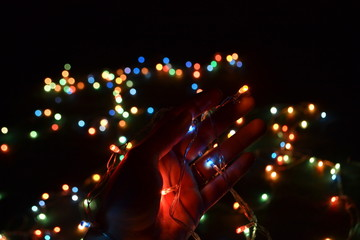Lights in hand and Bokeh of multicolor lights