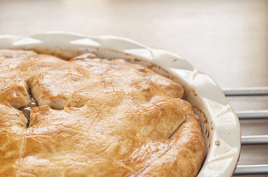 Freshly baked homemade apple pie on a wooden table
