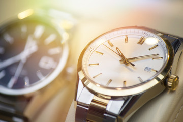 Beautiful stainless steel watch in front of other watches. Focus on the watch.