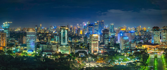 Beautiful skyline panorama of Jakarta city, Indonesia showing skyscraper buildings from top, aerial view at night. Papier Peint