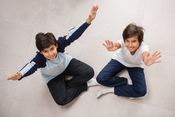 Two boys on ground