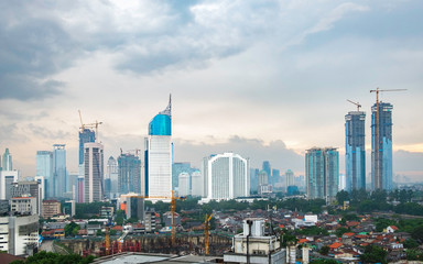 Iconic skyline of jakarta city, Indonesia, this is central of bussiness activity in Jakarta, captured at cloudy afternoon.  Contain one of most iconic building in Jakarta, represent whole Jakarta