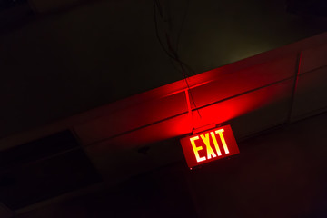 Illuminated red exit sign Wall mural