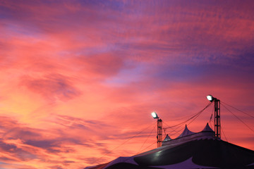 Circus tent under the colourful sunset sky