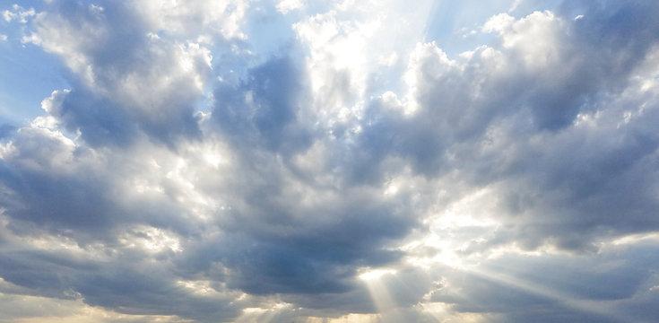 Dramatic blue cloudy sunrise sunset with sun rays sky overlay