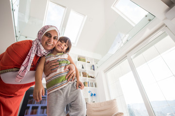 Happy mother and son at modern new white home