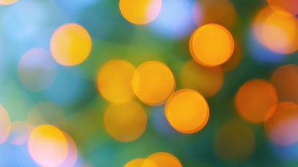 Abstract blur city rush  green yellow purple bokeh light background. Horizontal defocused image, copy space.