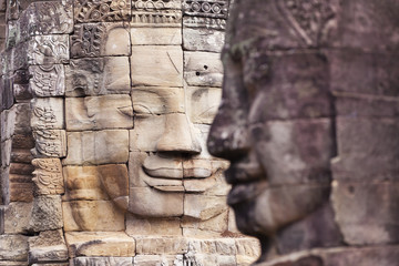 Smiling faces at Bayon Temple near Angkor Wat in Cambodia