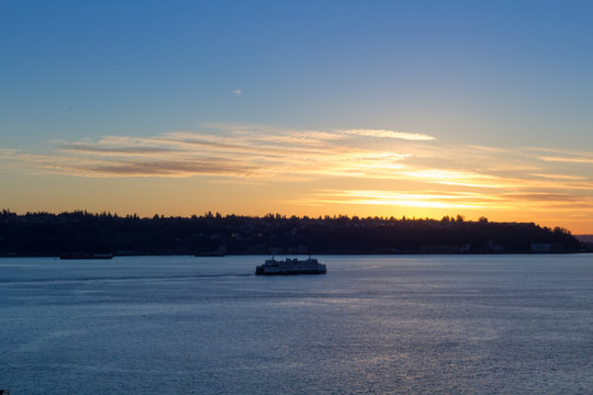 Boat on a winter sunset at Seattle waterfront