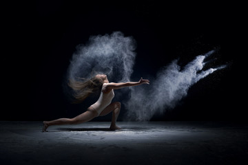 Contemporary dancer performing  in cloud of powder