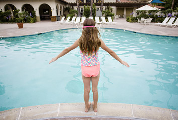 Child ready to play in a big swimming pool