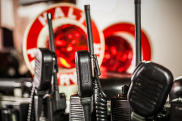 HDR - Feuerwehr und Polizei Equipment im Einsatzfahrzeug  mit Funkgerät