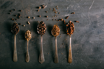 Spices on spoons shoot from above