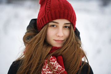 Beautiful girl posing winter day. Portrait of a teenager