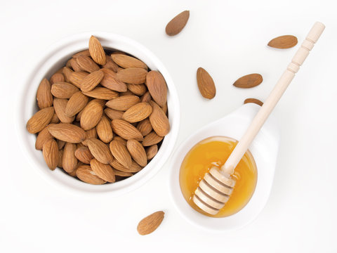 Honey and almond healthy snacks on white background