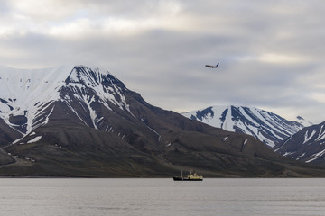 Arctic landscape with plane and ship  in Svalbard, Spitsbergen