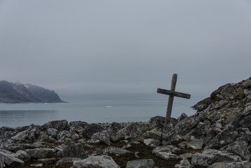 Old grave with cross in Svalbard, Spitsbergen