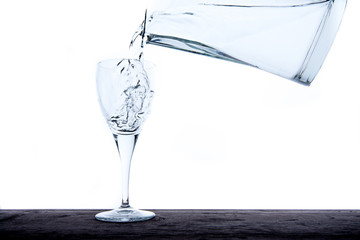 Filling glass with water from jug