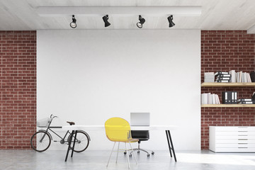 Front view of home office with yellow sofa