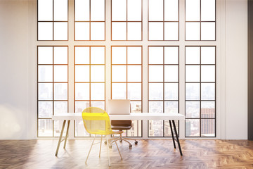 Workplace with white desk, an office chair and a transparent yellow visitor chair. Large windows are in the background. 3d rendering. Toned image