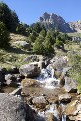 stream between rocks in the middle of the mountains in Pyrenees, Spain