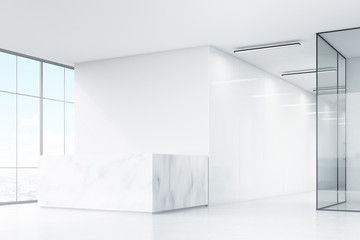 Corner of white office with marble desk