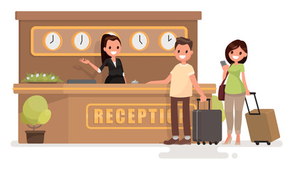 Check into a hotel. Young couple with suitcases is standing at t