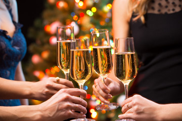 Women's hands with glasses of champagne.