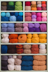 Colorful Balls Of Wool On Shelves.