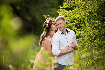 Couple in love hugging in spring garden and smiling. Love concept