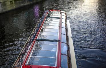 AMSTERDAM, NETHERLANDS - JANUARY 09, 2017: Boats on water in beautiful evening sun set. January 09, 2017 in Amsterdam - Netherland.